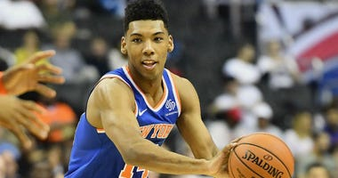 Allonzo Trier passes the ball against the Washington Wizards during the second quarter at Capital One Arena.