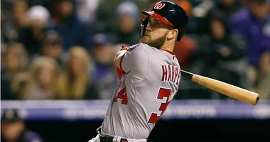 Bryce Harper bats in the fourth inning against the Colorado Rockies at Coors Field.