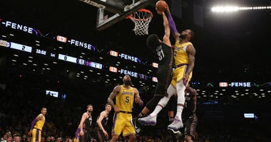 Jarrett Allen blocks a shot by Los Angeles Lakers small forward LeBron James (23) during the first quarter at Barclays Center.