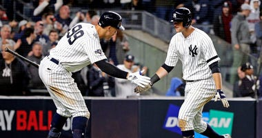 Oct 4, 2019; USA; New York Yankees third baseman DJ LeMahieu (26) celebrates with right fielder Aaron Judge (99) after hitting a solo home run during the sixth inning against the Minnesota Twins in game one of the 2019 ALDS playoff baseball series