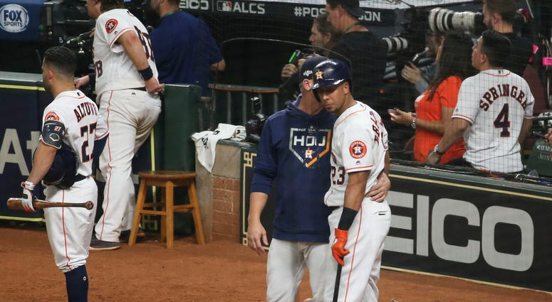 Oct 13, 2019; Houston, TX, USA; Houston Astros left fielder Michael Brantley (23) is visited by manager AJ Hinch (14) after Brantley hit a security guard with a foul ball in the fifth inning in game two of the 2019 ALCS playoff baseball series against the