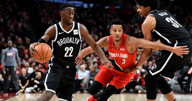 Brooklyn Nets guard Caris LeVert (22) drives to the basket past a pick set by Brooklyn Nets center Jarrett Allen (31) as Portland Trail Blazers guard CJ McCollum (3) defends during the first quarter of the game on Nov 8, 2019 at Moda Center.