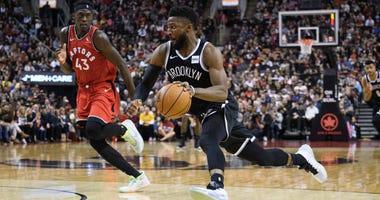 Nets guard David Nwaba drives to the basket against Toronto Raptors forward Pascal Siakam Dec 14, 2019; Toronto, Ontario, CAN