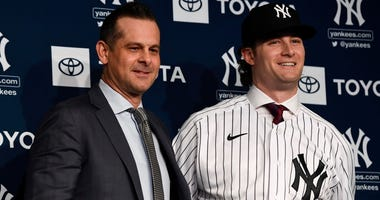 Yankees manager Aaron Boone, left, and pitcher Gerrit Cole pose for photos Dec 18, 2019; Bronx, NY