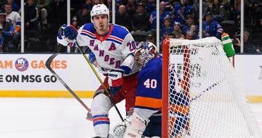 New York Rangers left wing Chris Kreider (20) collides with New York Islanders goaltender Semyon Varlamov (40) during the third period on Jan 16, 2020 at Nassau Veterans Memorial Coliseum.
