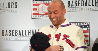 Former Yankees shortstop Derek Jeter tries on Hall of Fame hat and jersey Jan 22, 2020; New York, New York