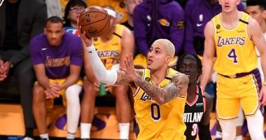Lakers forward Kyle Kuzma moves to the basket past Portland Trail Blazers guard CJ McCollum Jan 31, 2020; Los Angeles, California