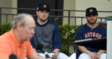 Houston Astros infielder Jose Altuve (right) and Alex Bregman (center) look on as Astros owner and chairman Jim Crane address the media on Feb. 13, 2020 before the morning spring training workout.
