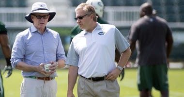 New York Jets general manager Mike Maccagnan (left) and owner Woody Johnson (center) and president Neil Glat (right) during training camp at Atlantic Health Jets Training Center