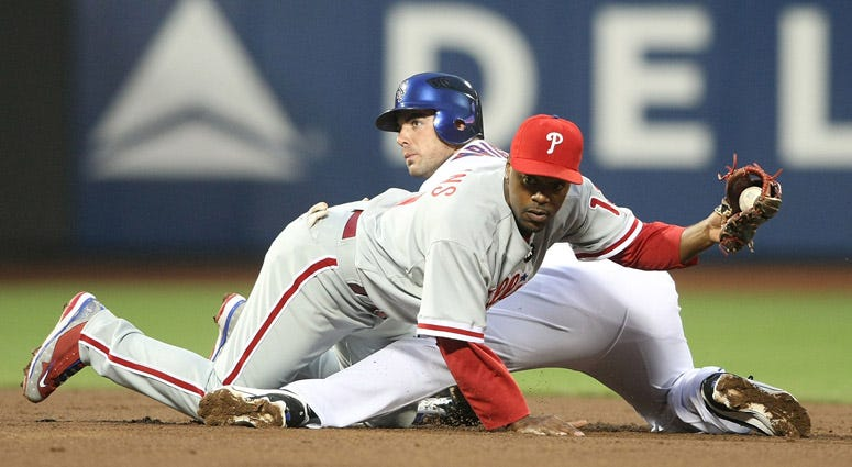The Mets' David Wright is tagged trying to steal second by Jimmy Rollins of the Philadelphia Phillies on May 6, 2009, at Citi Field.