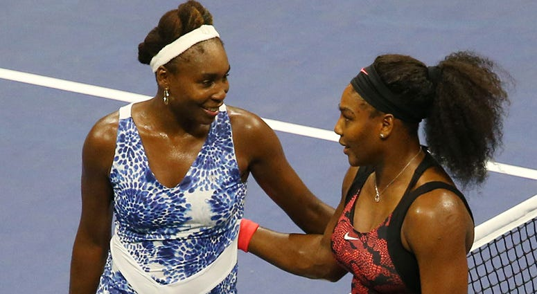 Sep 8, 2015; New York, NY, USA; Venus Williams of the United States (left) greets sister Serena Williams of the United States after their match on day nine of the 2015 U.S. Open tennis tournament at USTA Billie Jean King National Tennis Center. Mandatory