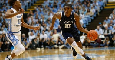 Yale guard Matthue Cotton drives against North Carolina Tar Heels guard Anthony Harris on Dec. 30, 2019, at Dean E. Smith Center in Chapel Hill, North Carolina.