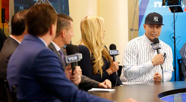 Yankees outfielder Giancarlo Stanton talks with the YES Network during the winter meetings at Walt Disney World Swan and Dolphin Resort on Dec. 11, 2017.