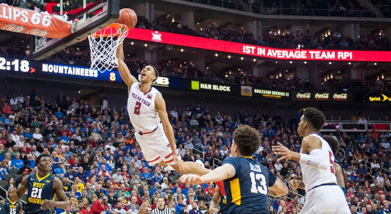 Texas Tech's Zhaire Smith shoots over West Virginia's James Bolden at the Big 12 Tournament semifinals March 9, 2018, in Kansas City, Missouri.