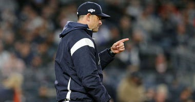 Yankees manager Aaron Boone signals for a pitching change during Game 5 of the American League Championship Series against the Houston Astros on Oct. 18, 2019, at Yankee Stadium.