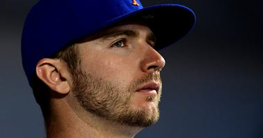 Mets first baseman Pete Alonso watches from the dugout