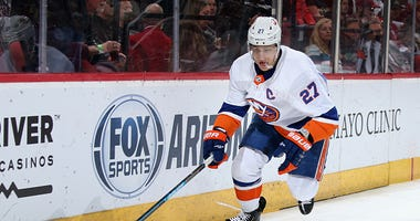 Islanders captain Anders Lee chases down the puck