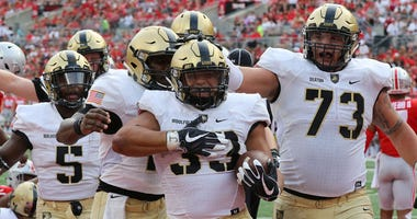 Army running back Darnell Woolfolk (33) celebrates a touchdown with teammates against Ohio State on Sept. 16, 2018, in Columbus, Ohio.