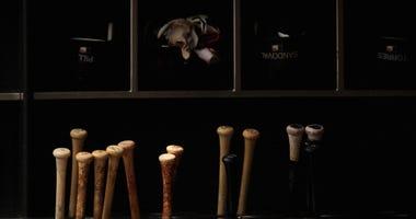 Baseball bats inside a dugout