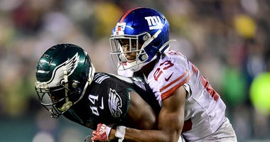 Giants CB Sam Beal tries to make a tackle against the Eagles.