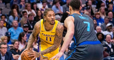 Michael Beasley looks to make a pass with the Lakers