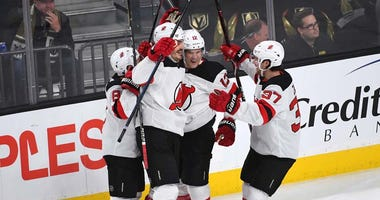 Devils defenseman Ben Lovejoy (12) celebrates with teammates after scoring a first period goal against the Vegas Golden Knights on Jan. 6, 2019, at T-Mobile Arena in Las Vegas.