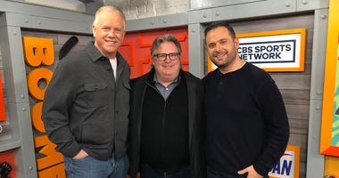 Boomer and Gio pose with Chef David Burke.
