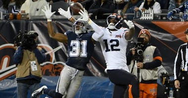 Dallas Cowboys cornerback Byron Jones (31) defends a pass intended for Chicago Bears wide receiver Allen Robinson (12) during the first half on Dec 5, 2019 at Soldier Field.