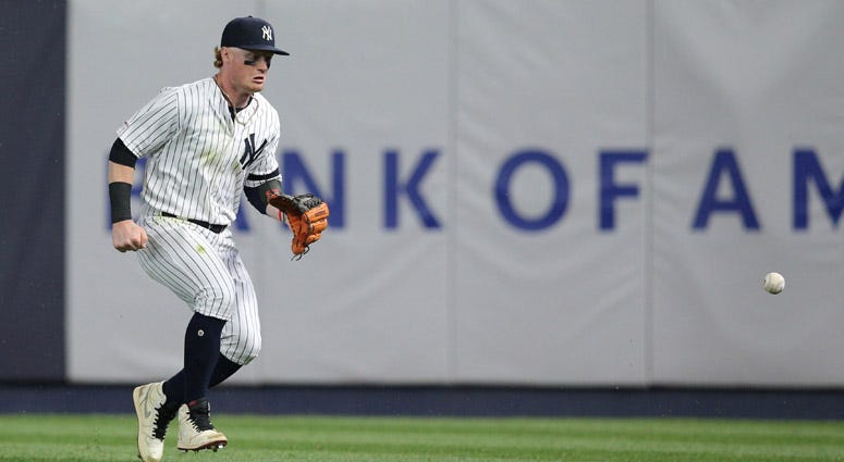 Yankees right fielder Clint Frazier chases a ball hit by the Red Sox's Michael Chavis that went for an RBI triple during the eighth inning at Yankee Stadium.