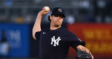 Gerrit Cole pitches during a Yankees spring training game.