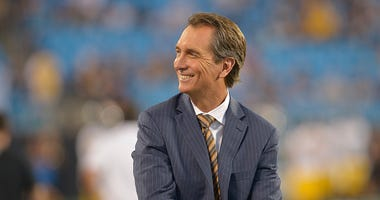 Cris Collinsworth on the field before a NFL game.