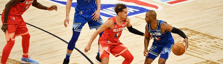 Chris Paul dribbles up to Trae Young in the 2020 All-Star Game.