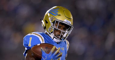 Darnay Holmes intercepts a pass for UCLA