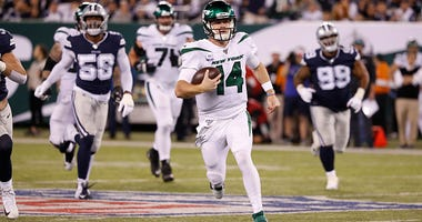 Sam Darnold picks up yards with his feet.