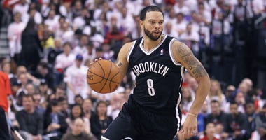 Deron Williams brings the ball up court for the Nets