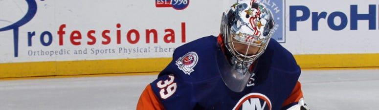 Islanders goalie Rick DiPietro makes a save.