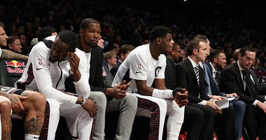 Kevin Durant sits on the bench during the game.