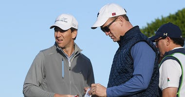 Eli and Peyton play a round of golf together.