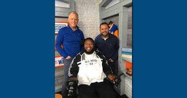 Eric LeGrand poses with Boomer and Gio.