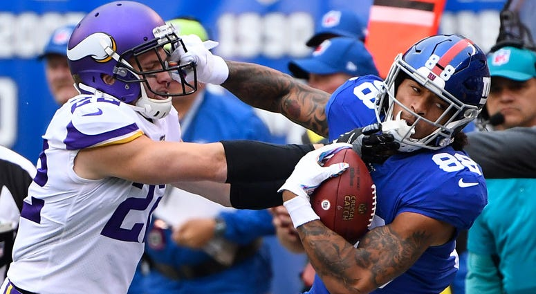 Giants tight end Evan Engram gets a first down in the first quarter as Vikings free safety Harrison Smith defends on Oct. 6, 2019, at MetLife Stadium.