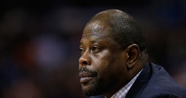 Patrick Ewing sits on the bench during a Hornets game.