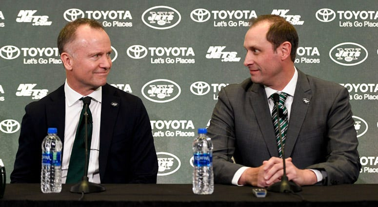 Jets Chairman and CEO Christopher Johnson (left) and coach Adam Gase