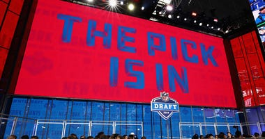 """A video board displays the text """"THE PICK IS IN"""" for the New York Giants during the first round of the 2018 NFL Draft at AT&T Stadium on April 26, 2018 in Arlington, Texas."""