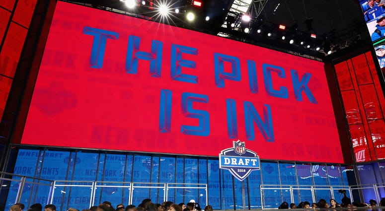 "A video board displays the text ""THE PICK IS IN"" for the New York Giants during the first round of the 2018 NFL Draft at AT&T Stadium on April 26, 2018 in Arlington, Texas."