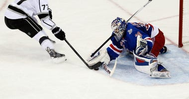 Henrik Lundqvist stops a shot from Jeff Carter in Game 4 of the 2014 Stanley Cup Final