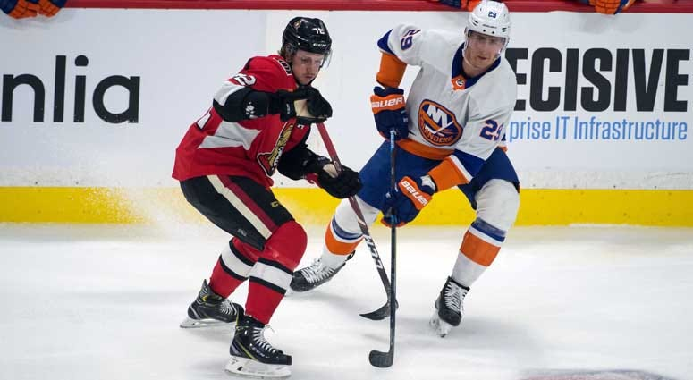 Senators defenseman Thomas Chabot battles with Islanders center Brock Nelson in the third period on March 5, 2020, at the Canadian Tire Centre in Ottawa, Ontario.