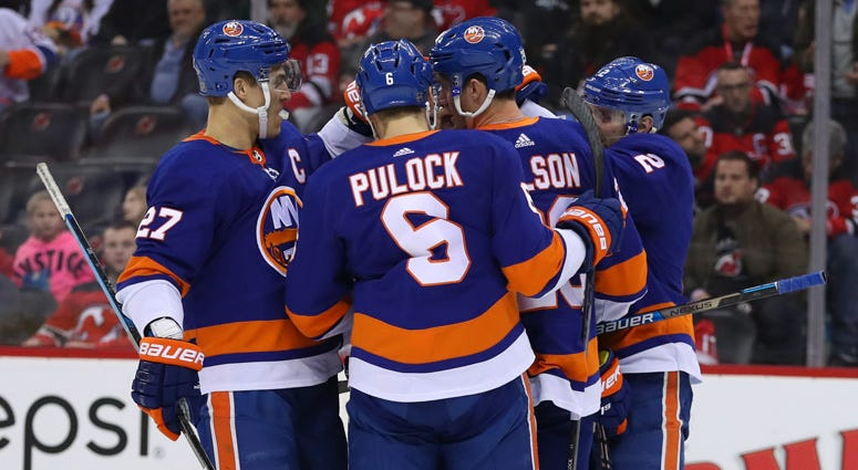 The Islanders celebrate after a goal by right wing Jordan Eberle against the New Jersey Devils on Jan. 7, 2020, at the Prudential Center.
