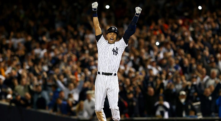 The Yankees' Derek Jeter celebrates after a game-winning RBI hit in the ninth inning against the Baltimore Orioles in his last game ever at Yankee Stadium on September 25, 2014 in the Bronx borough of New York City.