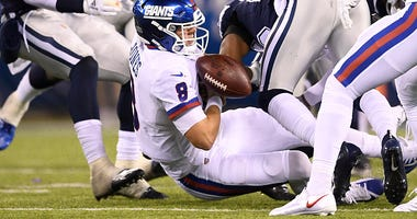 Daniel Jones loses the football in a game against the Cowboys.