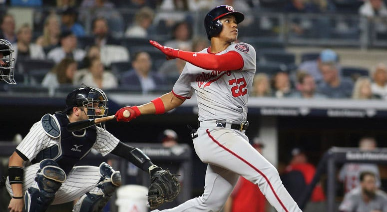 The Nationals' Juan Soto hits a home run in the seventh inning against the Yankees on June 13, 2018, at Yankee Stadium.